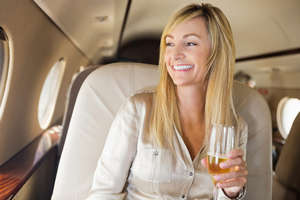 Girl drinking champagne on the plane