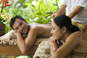 Woman and man on spa treatments