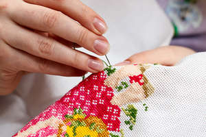 Woman embroiders