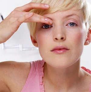 Girl massages the eye