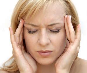 A woman has a headache
