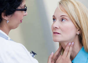 The doctor examines the lymph nodes in the neck