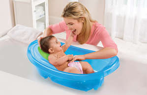 Mom bathes the baby