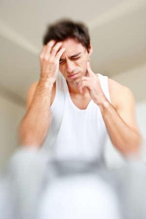 The man has a headache