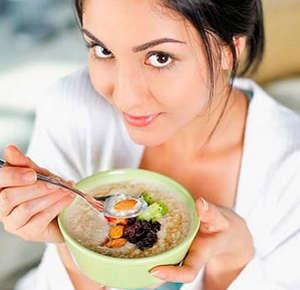 Girl eating porridge