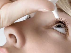 Girl applies eye drops