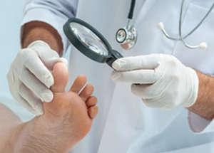 Doctor examines legs