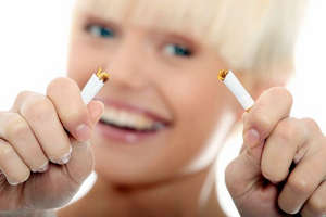 Girl breaks a cigarette