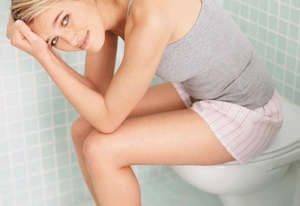 Girl sitting in the toilet
