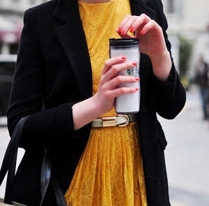 Red manicure under the yellow dress