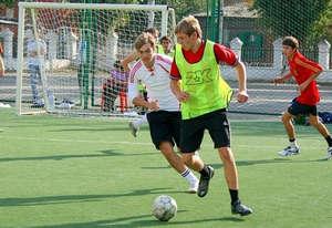Guys play football