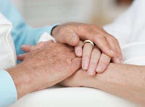 Hands of an elderly couple