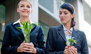 Girls holding flower pots