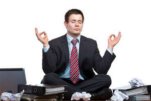 Man in a suit is meditating