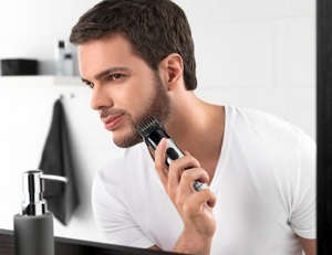 Man using trimmer at home