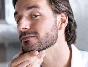 Man examines a beard