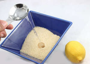 Pouring sugar in water with lemon
