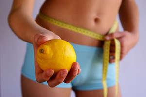 Girl holding a lemon
