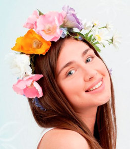 Girl with a wreath of flowers