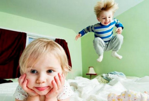 Baby jumping on the bed