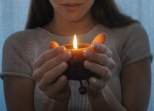 Girl with a candle in her hands