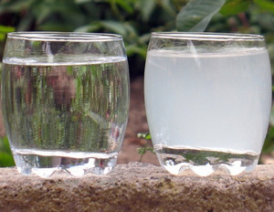 Two glasses with clear and muddy water