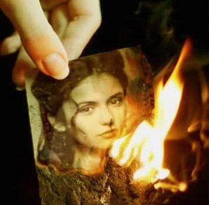 Burning photo of a woman in her arms