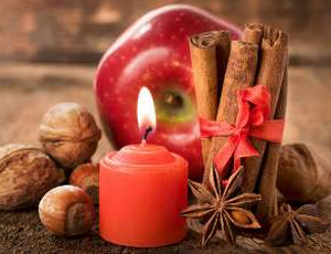 Red candle, apple and cinnamon