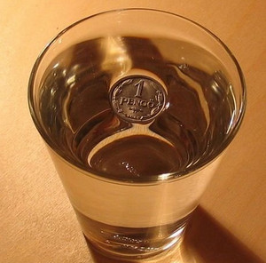 Coin in a glass of spring water