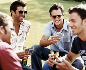 Men play cards and drink beer