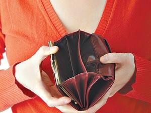 Empty wallet in hand