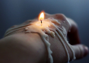 Wax candle on hand