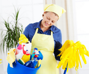 Woman cleans the house