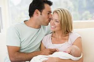 Husband kisses wife