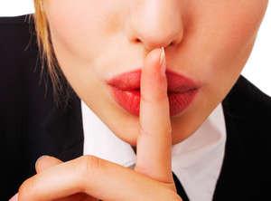 Girl holds finger at mouth