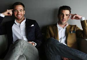 Two men sit