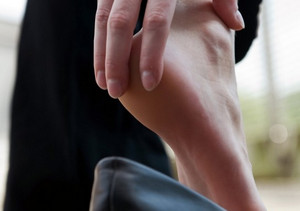 Woman holding her heel