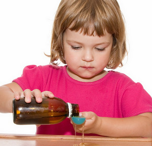 Girl pours cough syrup