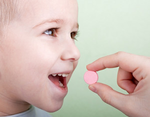 Child takes a pill