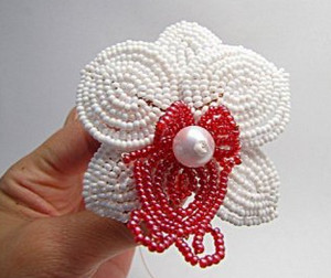Orchid flower of white and red beads