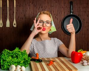 The girl with glasses preparing dinner for her husband