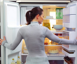 The girl opened the fridge to clean everything