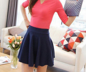 Girl in a red blouse and a short blue skirt