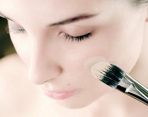 Applying foundation cream with a brush