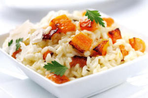 Dish of rice, carrots and plums