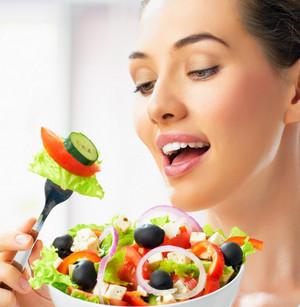 Girl eats dietary vegetable salad