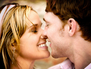 Man and woman laughing with eyes closed