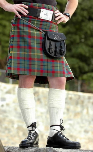 A man in a plaid red-green skirt and white golf