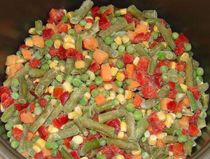 Frozen vegetables in the multicooker bowl
