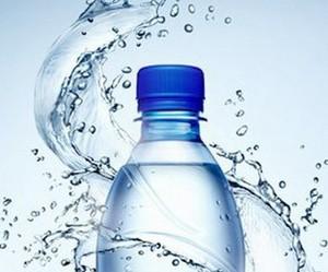 Water spray around the bottle